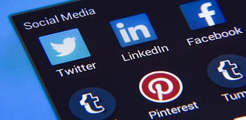 Social media icons on a smartphone screen, Twitter, Linkedin, Facebook, Tumblr, Pinterest